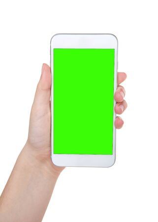 Young caucasian hand holding white cell phone with green screen, isolated on white.