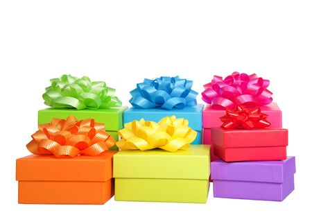 Piles of small colorful bright holiday presents with ribbons and bows isolated on white background. Birthday, anniversary, Mother's Day, etc theme'd Archivio Fotografico