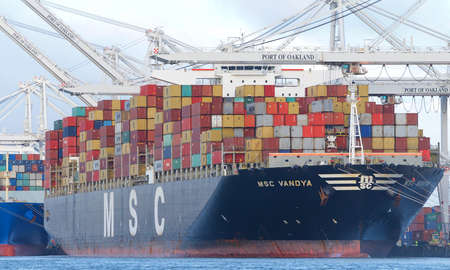 Oakland, CA - Jan 9, 2020: Cargo Ship MSC VANDYA loading at the Port of Oakland. Mediterranean Shipping Company, MSC, is the worlds 2nd largest shipping line in terms of container vessel capacity. Publikacyjne