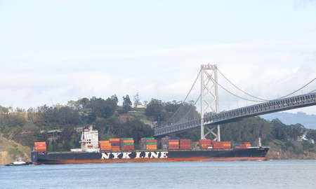 San Francisco, CA - Jan 13, 2020: Cargo Ship NYK DENEB in the San Francisco bay in route to the Port of Oakland, the fifth busiest port in the United States. Publikacyjne
