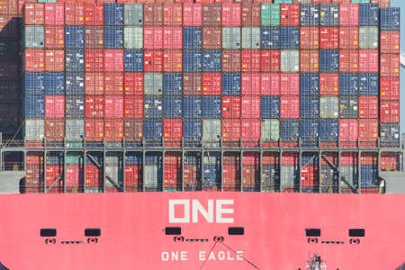 Oakland, CA - June 3, 2020: Cargo Ship ONE EAGLE departing the Port of Oakland loaded with shipping containers. Containers are organized and placed algorithmically for efficient transport.