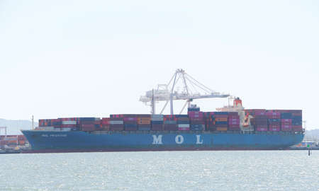 Oakland, CA - May 6, 2020: Cargo Ship MOL PRESTIGE loading at the Port of Oakland.  Mitsui O.S.K. Lines, Ltd. is a Japanese transport company, one of the largest shipping Co in the world. Publikacyjne