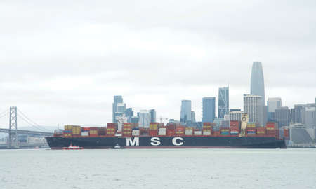 San Francisco, CA - Apr 16, 2020: MSC ANNA, the largest container ship to ever dock at the Port of Oakland, in the San Francisco Bay en route to the port.
