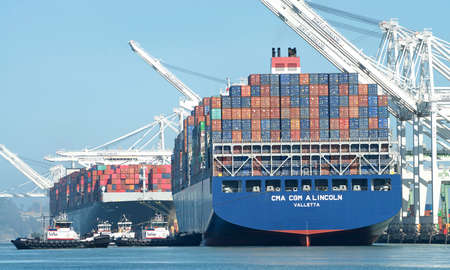 Oakland, CA - June 30, 2020: Cargo Ship CMA CGM A. LINCOLN entering the Port of Oakland, the fifth busiest port in the United States.