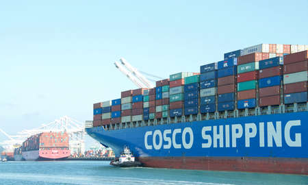 Oakland, CA - July 25, 2020: Cargo Ship COSCO AMERICA entering the Port of Oakland. China Ocean Shipping Company, COSCO is government owned by the People's Republic of China.