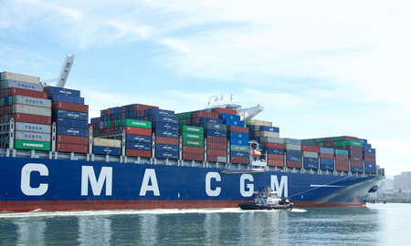Oakland, CA - June 10, 2020: Cargo ship CMA CGM T. JEFFERSON entering the Port of Oakland. Compagnie Generale Maritime (CMA CGM) is the third largest shipping company in the world.