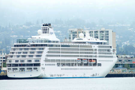 Oakland, CA - June 25, 2020: Seven Seas Mariner, a Regent Seven Seas Cruises line was the first all-suite, all-balcony ship in the world. Currently docked at the Port of Oakland due to the coronavirus