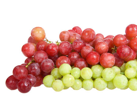 Bunch of green grapes with red grapes with water drops on them, isolated on white background.