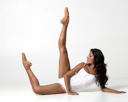 20 24 years old: Ballerina stretching on the floor Stock Photo