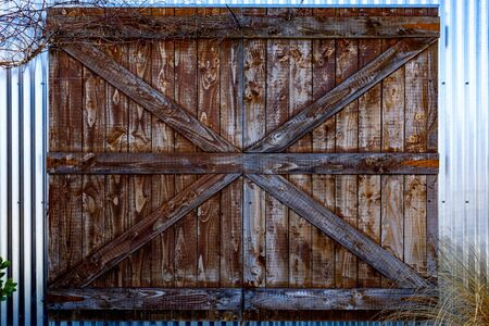 A Left Old Rustic Barn Door on a TIn Shed. Modern Meets Aged Architecture