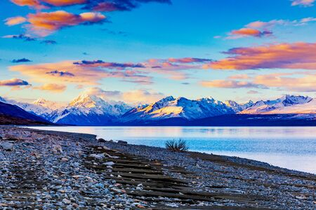 A Vibrant Sunset On Lake Pukaki Watching As The Light Falls Away From Aoraki/Mount Cook
