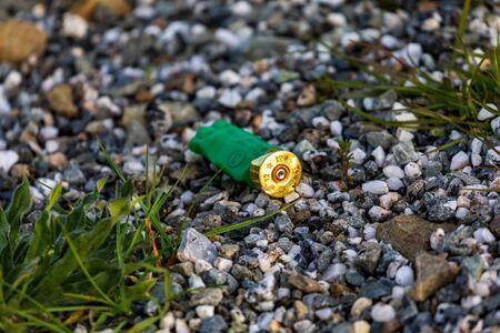 A Spent Shotgun Shell On The Roadside