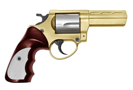 Revolver of gold color and ruby color a handle  It is isolated on a white background  photo