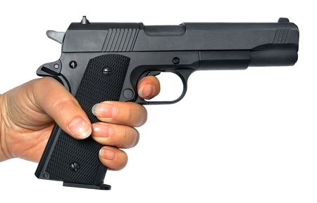 black grip: Pistol in a hand it is isolated on a white background Stock Photo