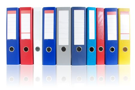 vibrance: Row of multicolored ring binders with reflection.