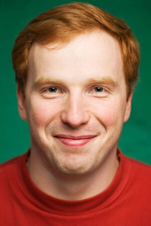Portrait of the man on green background. Stock Photo
