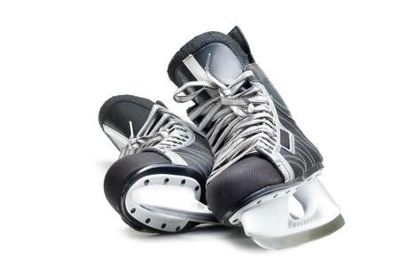 Mans hockey skates. Isolated on white background.