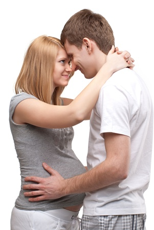 Young pregnant couple. Isolated on white background. Stock Photo