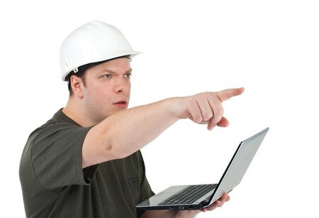 superintendent: Malicious construction superintendent in a white helmet with the laptop in hands pointing on something. Isolated on white background.