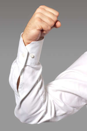 elbow sleeve: Businessman flexing his arm muscles.