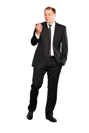 Businessman in black suit walking. Isolated on white background.  photo