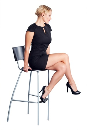 Attractive women on chair in studio. Isolated on white background. Stock Photo