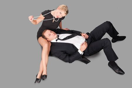 Glamour caucasian man and women lies on a floor resting after party photo