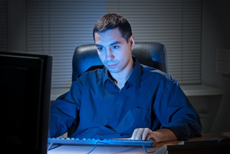 Businessman working late in his office.