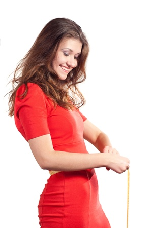 scales thin: Beautiful caucasian women hold a tape measure and happy. Isolated on white background.