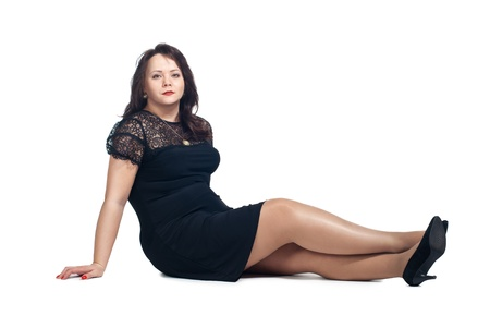 thick hair: Young woman sitting on the floor. Isolated on white background.