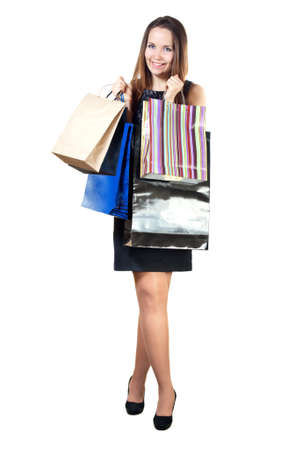 Beautiful woman with shopping bags. Isolated on white background. Stock Photo - 9227071