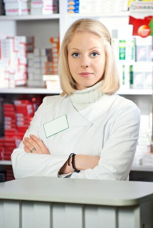 Portrait of a female pharmacist at pharmacy Stock Photo - 9240185