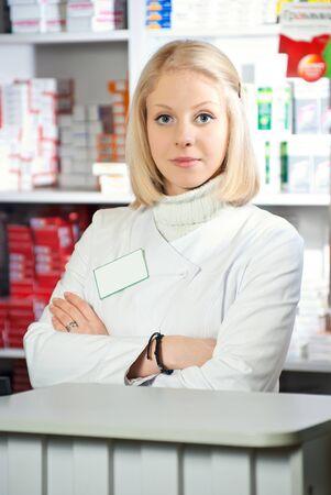Portrait of a female pharmacist at pharmacy Stock Photo - 9240185