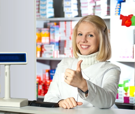 Shot of woman pharmacist give OK sign and smiling to camera. photo