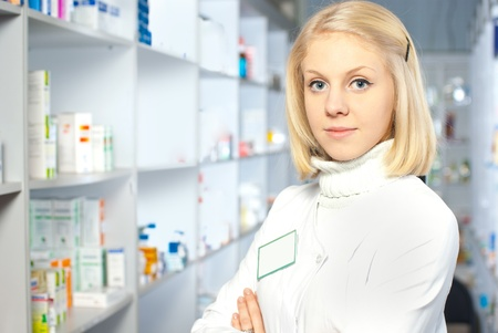 Portrait of a female pharmacist at pharmacy Stock Photo - 9240129