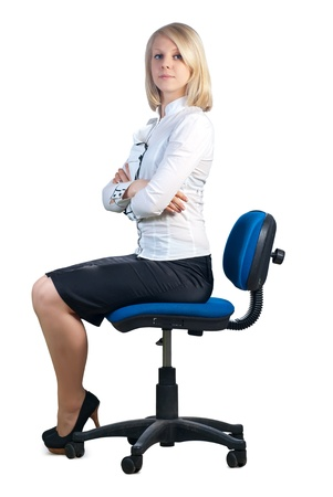 Attractive young caucasian businesswoman sitting in office chair. Isolated on white background. photo