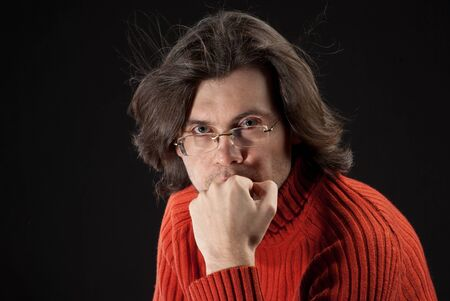 log hair: Man with log hair in red sweater and glasses.