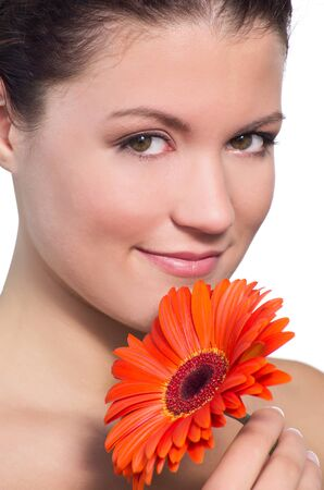 Skincare of young beautiful woman face with fresh flower. Isolated on white background  Stock Photo - 10291377