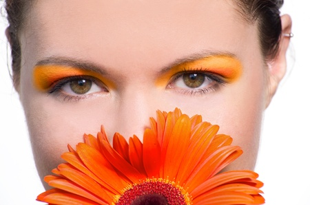 Skincare of young beautiful woman face with fresh flower. Isolated on white background Stock Photo - 10291376