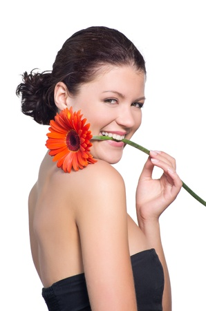 Skincare of young beautiful woman face with fresh flower. Isolated on white background