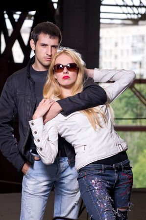 Shoot of glamour young caucasian couple against urban background photo