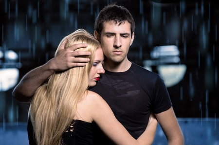 Shoot of glamour young caucasian couple against urban background Stock Photo - 10444102