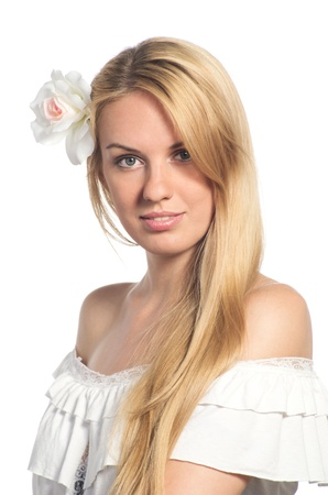 Portrait of beautiful woman with healthy skin with flower in her hair. Isolated on white background. photo