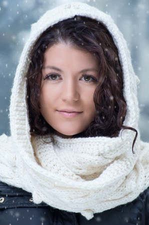 Pretty young caucasian brunette woman wearing white scarf with hood in a outdoor winter portrait  Stock Photo - 10762210