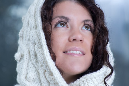 Pretty young caucasian brunette woman wearing white scarf with hood in a outdoor winter portrait Stock Photo - 10762206