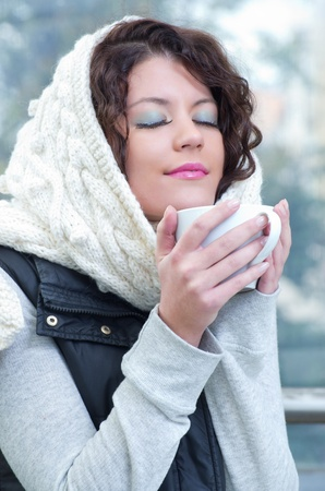 Pretty young caucasian brunette woman wearing white scarf with hood in a outdoor winter portrait  Stock Photo - 10762203