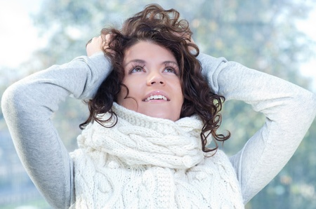 Pretty young caucasian brunette woman wearing white scarf with hood in a outdoor winter portrait Stock Photo - 10762205