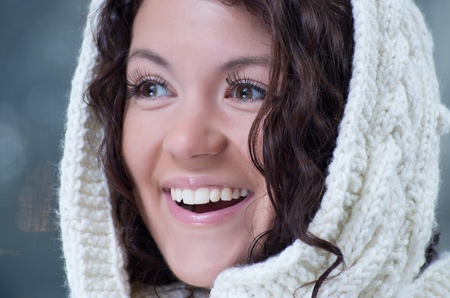 Pretty young caucasian brunette woman wearing white scarf with hood in a outdoor winter portrait Stock Photo - 10762208