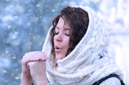 Pretty young caucasian brunette woman wearing white scarf with hood in a outdoor winter portrait  Stock Photo - 10815635