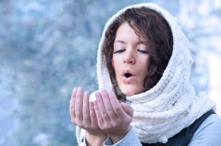 Pretty young caucasian brunette woman wearing white scarf with hood in a outdoor winter portrait Stock Photo - 10815640